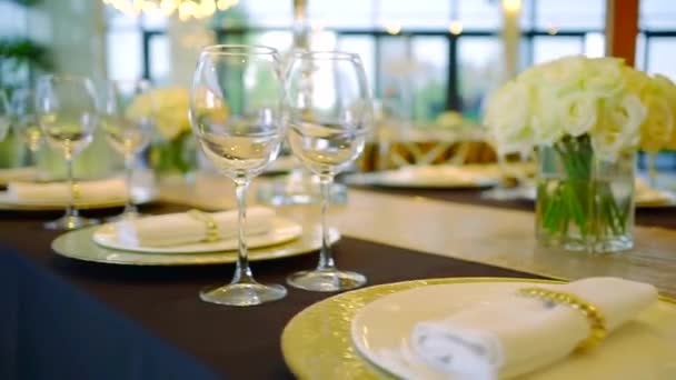 close-up moving shot of long served table in a restaurant in wedding day before gala dinner