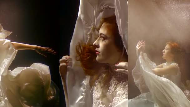 Vertikální video hezká dívka s červenými vlasy pod vodou v bílých šatech, jako v pohádce mořská panna plave pod vodou
