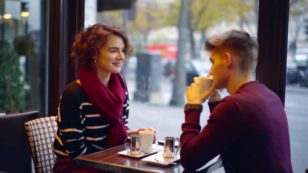Beautiful couple having a nice date in a cafe together.