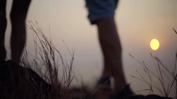 Blurred shot of a couple watching sunset from the hill on tropical vacation.