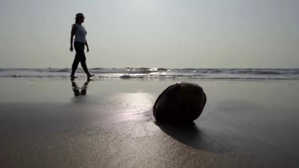 Silhouette of a woman walking on the beach, relaxation on the island, tropical beach.