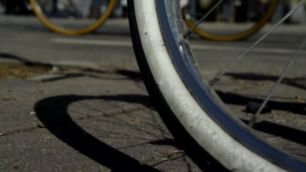 Close-up shot of a bicycles tires, man riding a bike outside in spring.