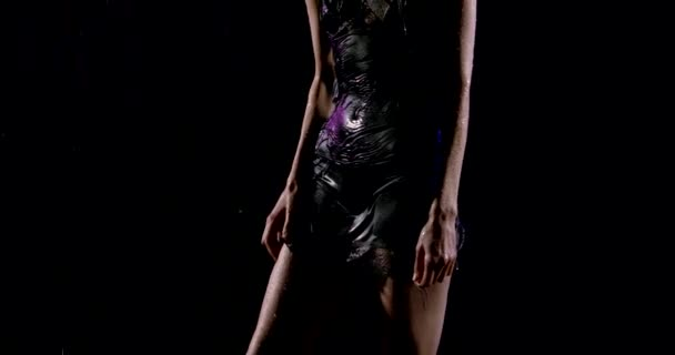 sexy slender woman is dressed in black lace dress, standing in dark street under rain, clothes is wet