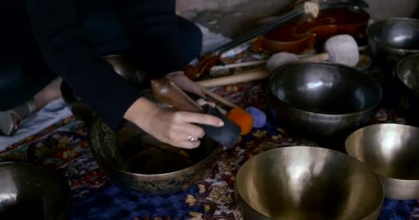 Close up female hand Zen meditation on a Tibetan singing bowl
