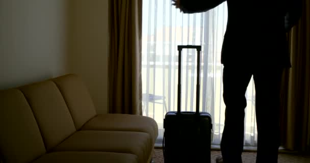 emotional man silhouette walks about dark hotel room