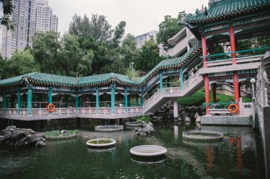 Wong Tai Sin District, New Kowloon, Hong Kong - September 2018 : Wong Tai Sin Temple from front area with Girl. Most famous Taoist temple exemplifies the architecture of a traditional Chinese temple.