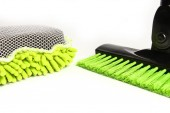 stylish scraper brush with a washcloth for cars on a white backg