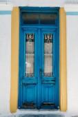 blue vintage doors of white building