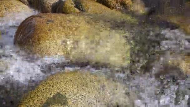Pure glacial water. Mountain glacial river in the mountains of Kyrgyzstan
