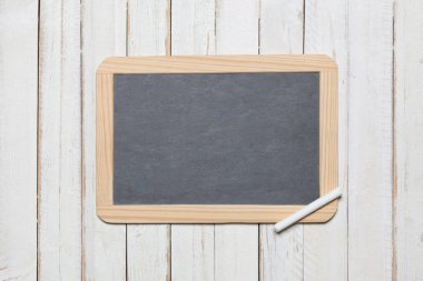 chalk blackboard on a white wooden deck background with copy space for your text