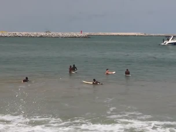 holidaymakers, tourist are having fun on a typical weekend in Tarkwa bay beach, Lagos, Nigeria. Eko Atlantic city and Lagos port is visible in the background