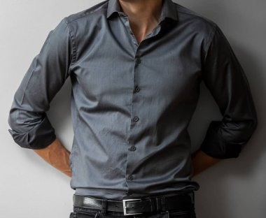 Cropped Head young Caucasian Man in a smart dress shirt with hands behind his back