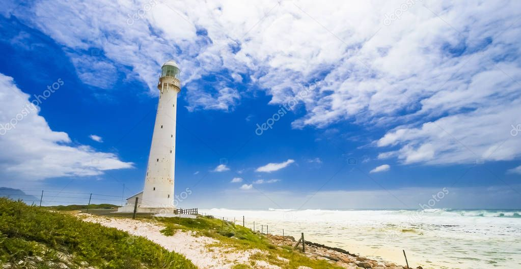 Lighthouse on the rugged Cape Town South Africa coastline during the day