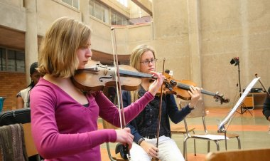 Diverse youth at music school orchestra