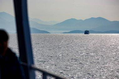 Ferryboat in Greece, sunny winter landscape