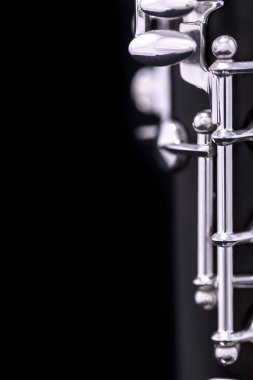 A new silver plated clarinet on a black background