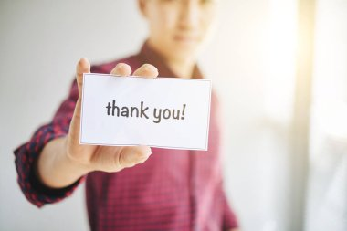man showing card with text thank you