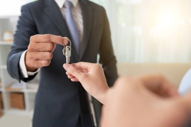 Hand of woman taking keys from hand of real estate owner stock vector