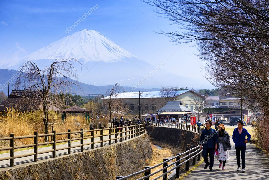 TOKYO JAPAN - APRIL 3, 2018 : Iyashinosato ancient japanese village,  Popular tourists walk the old village to learn history throughout the life & buy a gift back. Behind the scene is Mt. Fuji.