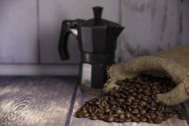 coffee beans coming out of a sack