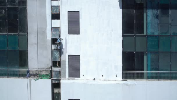 Exterior painting work of high rise  infrastructure building at construction site.