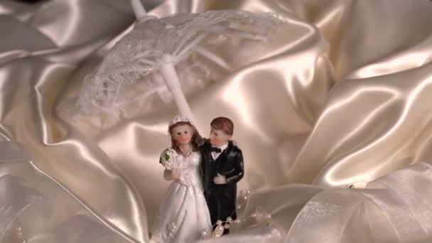 wedding decoration of toy couple of bride, groom figures and champange glasses