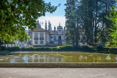 Vila Real / Portugal - 08 01 2020: View of the Solar de Mateus exterior building, iconic of the 18th century Portuguese baroque, lake with building reflection