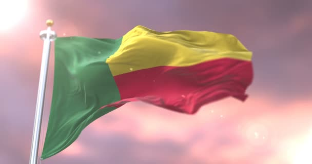 Benin flag waving at wind in slow at sunset, loop