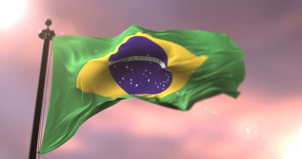 Flag of Brazil waving at wind in slow at sunset, loop
