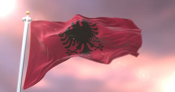 Albania flag waving at wind at sunset, loop