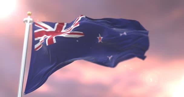 Új-Zéland zászlót lengetve szél, napnyugtakor a lassú, hurok