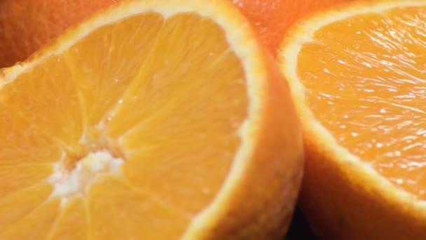 Fresh and naturals oranges cut gyrating