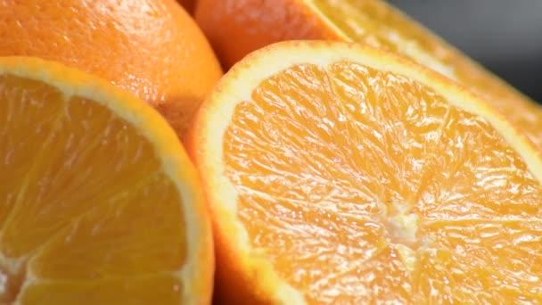 Fresh natural oranges cut gyrating