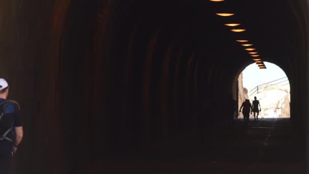 People walking in a tunnel