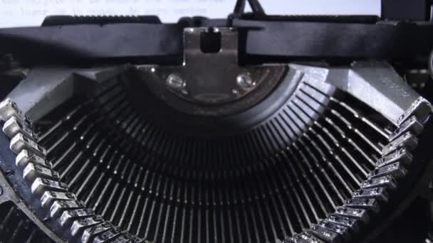 Letters hitting the paper while typing in an old qwerty typewriter with sound