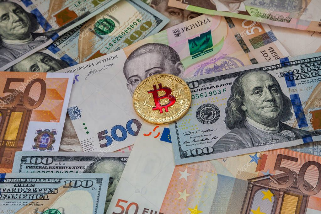 Cash banknotes and bitcoin on the table.