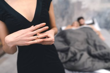 Close up of woman hand removes wedding ring