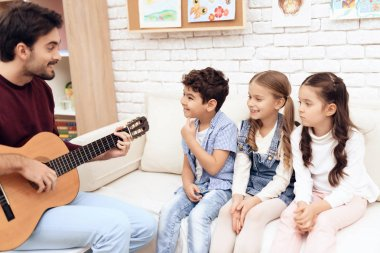 Children have a lesson in music.