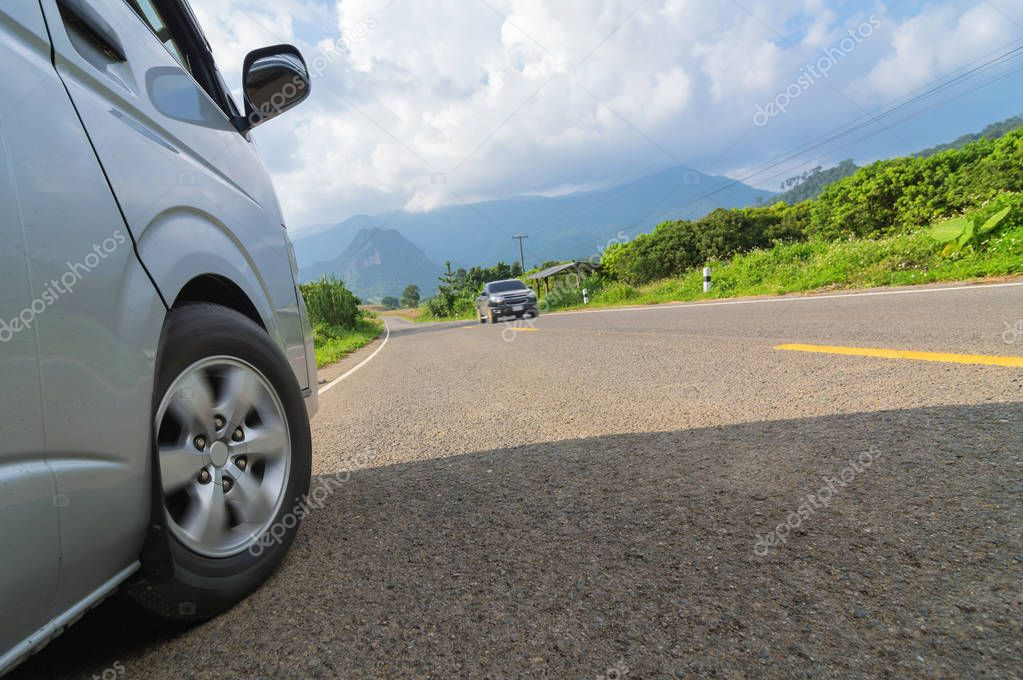 Silver van car parking on the asphalt road.
