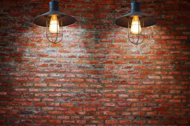 Vintage metallic lanterns, Decorative antique edison style light bulbs against brick wall background.