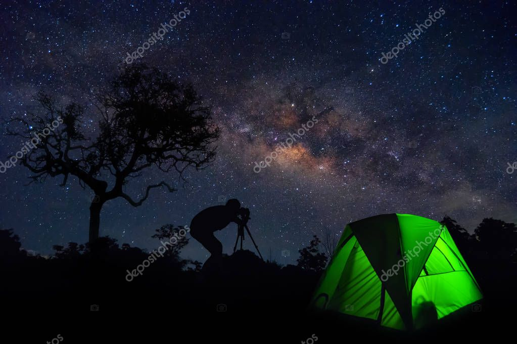 Milky Way with stars and tent in foreground, Traveler camping in the North Thailand, Lampang.