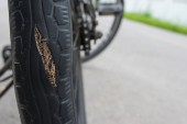 Fotografie Tire breaks, swelling, danger signals, warning time to change tires.