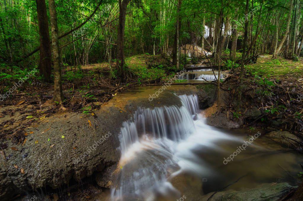Фотообои Pha Tad Waterfall is a three-tiered waterfall located deep inside the Khuean Srinagarindra National Park Kanchanaburi.