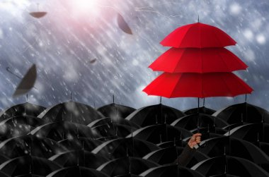 Insurance agent holding red umbrella three layers to protect the life, health, savings, investment and accident, Insurance concept.