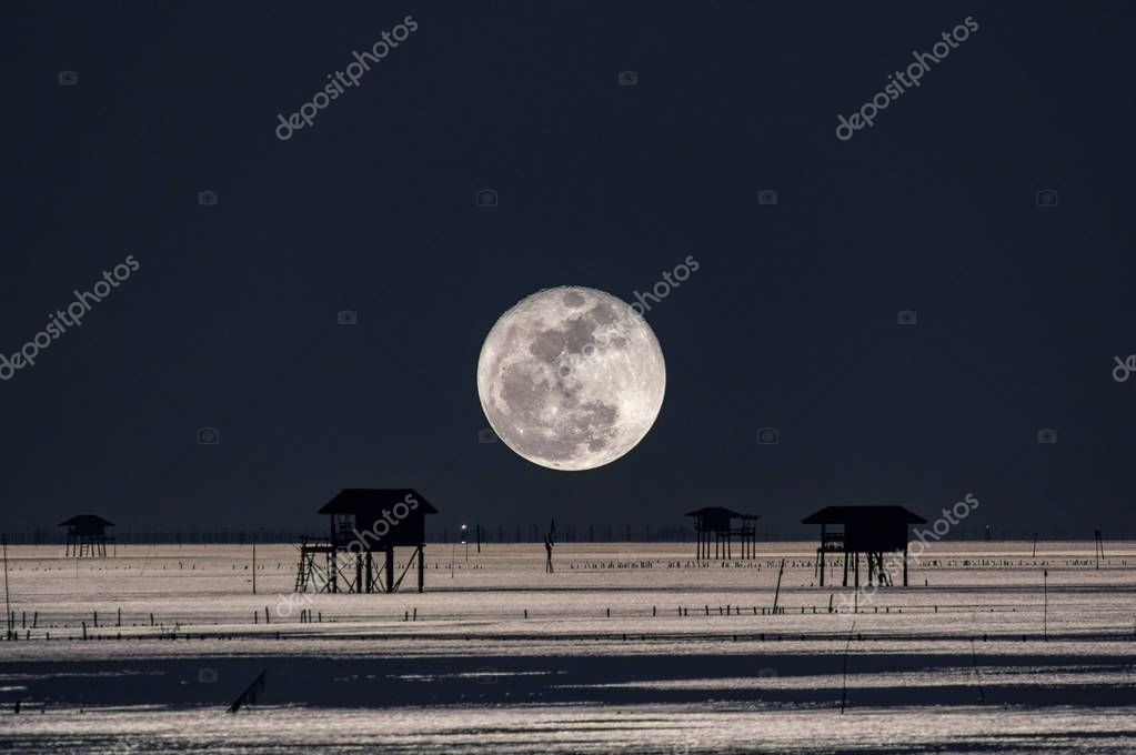 Full moon at dusk over House in the sea, Bang Ta Boon, Petchaburi, Thailand, Asia.