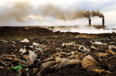 Industrial waste and air pollution with black smoke from chimneys.