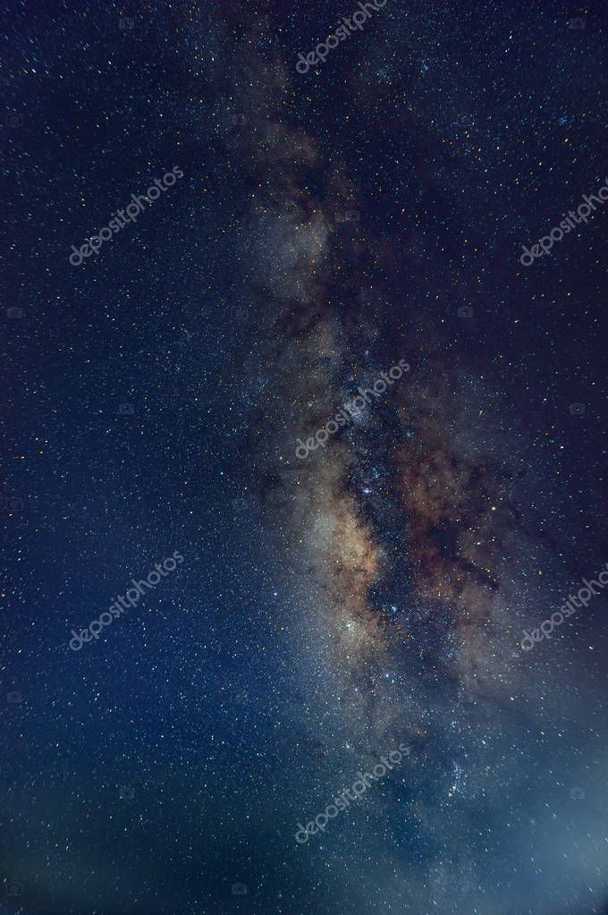 Vertical Milky way galaxy with stars and space dust in the universe, long speed exposure.