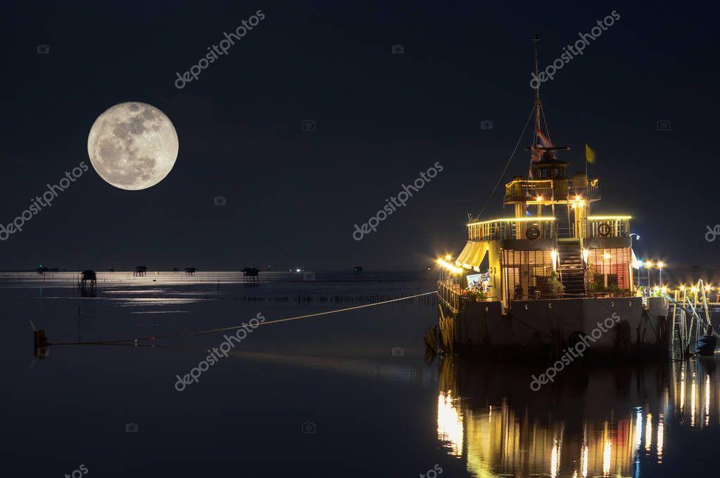 Full moon at dusk over House in the sea, Bang Ta Boon, Petchaburi, Thailand, Asia.