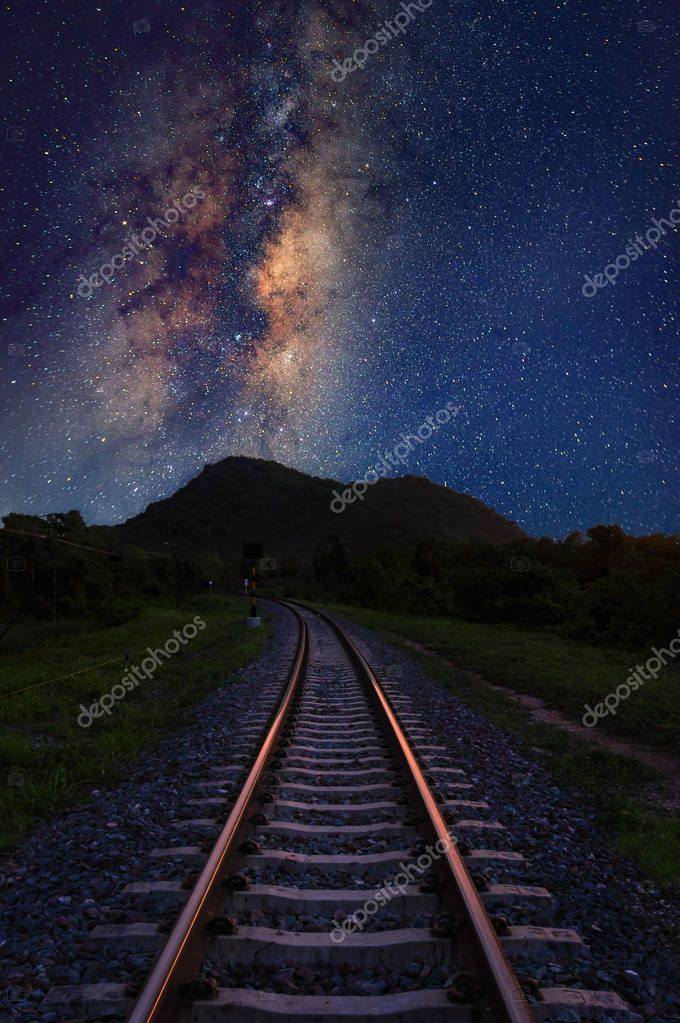 Vertical Milky way galaxy stars and space dust in the universe with railway foreground, long speed exposure.