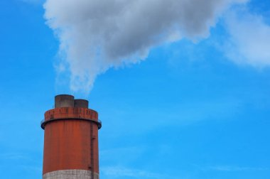 Smoke, steam on the chimney of coal power plant, Air Pollution, Steam power plant. Blow-off